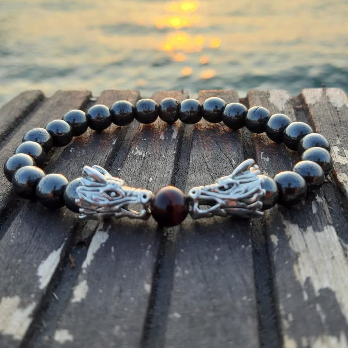 bracelet with hematite beads, red tiger eye and metallic dragons