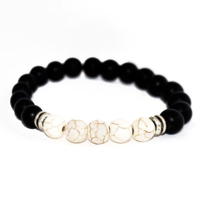 bracelet with white howlite, black onyx beads and metallic elements