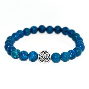 bracelet with blue howlite beads and metallic element