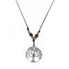 black snake cord necklace with metallic rounded tree of life and wooden beads