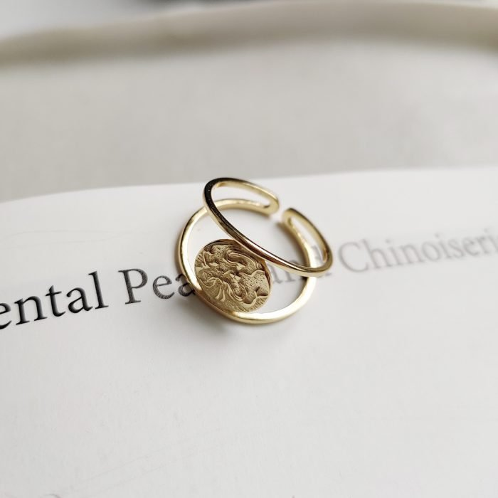 woman's gold silver ring with mermaid