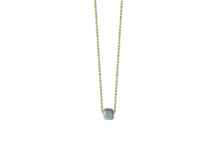 gold necklace with light blue ceramic cube